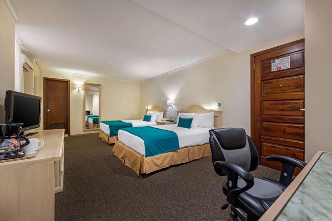 Quality Inn Aguascalientes - Aguascalientes - Schlafzimmer