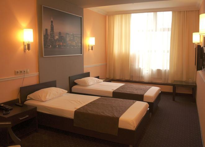 Eugene Hotel - Moskau - Schlafzimmer