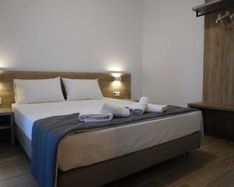 Hotel Vozina - Metamorfosi - Schlafzimmer