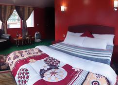 لاما هوتل - Lukla - غرفة نوم