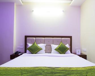 Treebo Trip Sun Square - Vijayawada - Bedroom