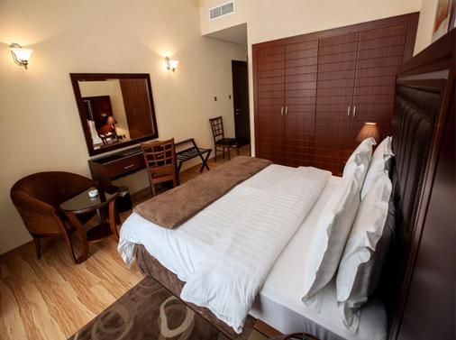 Xclusive Maples Hotel Apartment - Dubai - Bedroom
