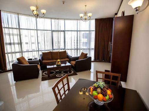 Xclusive Maples Hotel Apartment - Dubai - Comedor