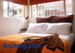 6號套房酒店 - 波哥大 - 臥室