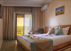 Hotel Al Mamoun - Ait Melloul - Bedroom