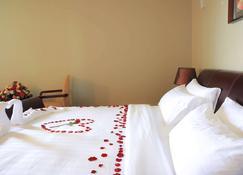 Magnolia Addis Hotel - Addis Ababa - Yatak Odası