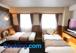 Hotel Areaone Kochi - Kochi - Phòng ngủ