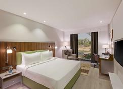 Country Inn & Suites by Radisson Zirakpur - Zerakpur - Schlafzimmer