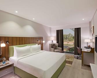 Country Inn & Suites by Radisson Zirakpur - Zerakpur - Спальня