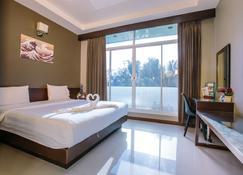 โรงแรมจินตนารีสอร์ท - บุรีรัมย์ - ห้องนอน