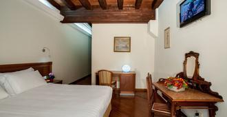 Hotel Flora - Cagliari - Yatak Odası