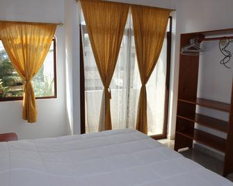 Galapagos Best Hostel - Пуерто-Айора - Bedroom