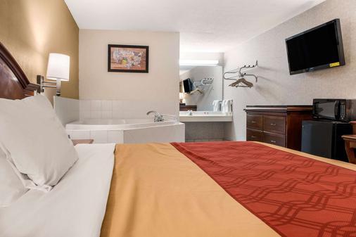 Econo Lodge - Holland - Schlafzimmer