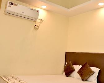 Hotel Maple Inn - Patna - Slaapkamer