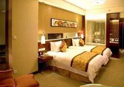 Ramada by Wyndham Zibo - Zibo - Bedroom
