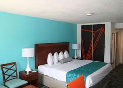 Howard Johnson by Wyndham Hattiesburg - Hattiesburg - Bedroom