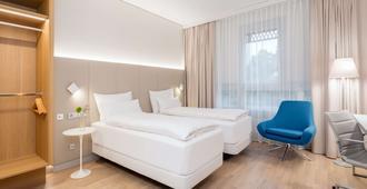 NH Graz City - Graz - Camera da letto