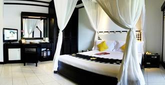 Candi Beach Resort & Spa - Manggis - חדר שינה