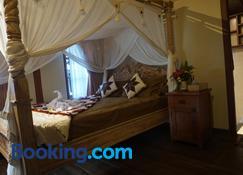 Mirah Guest House by Gangga - Tampaksiring - Bedroom