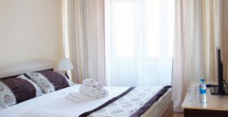 Aksunkar Hotel - Almatý - Habitación