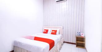 OYO 1421 Kasmaran Guest House Syariah - Jakarta - Bedroom