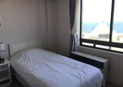 Jeju Seoul Tourist Hotel - Jeju City - Makuuhuone