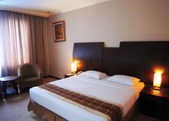 푸라야 호텔 - 페칸바루 - 침실
