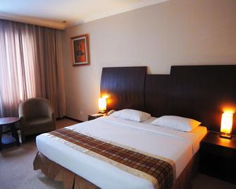 Furaya Hotel - Pekanbaru - Bedroom