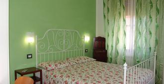 Bed & Breakfast Myosotis - Pisa - Schlafzimmer