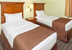 Grand Beach Resort By Diamond Resorts - Lake Buena Vista - Makuuhuone