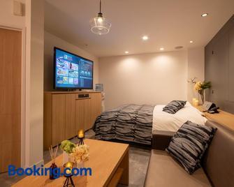 Hotel Waraku Shibukawa - Shibukawa - Schlafzimmer