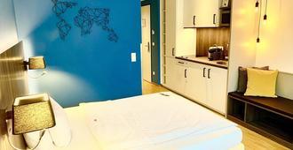 Zeitwohnhaus Suite Hotel & Serviced Apartments - ארלנגן - חדר שינה