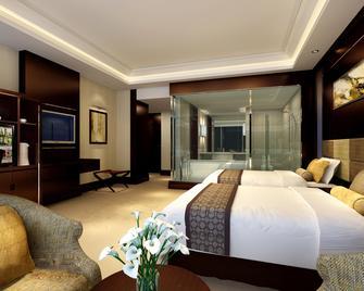 Huafang Jinling International Hotel Zhangjiagang - Zhangjiagang - Спальня