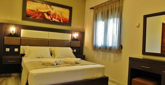 Sunday Summer Resort - Gerakini - Schlafzimmer
