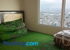 Robert's Condominium - Jakarta - Schlafzimmer