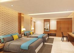 Cygnett Inn Trendz - Itanagar - Schlafzimmer