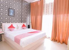 โรงแรมโอโย 854 ยูบี ไกซาร์ - บันดาร์อาเจะห์ - ห้องนอน
