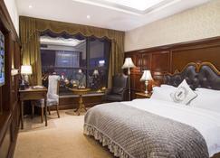 Yiwu Yueting international hotel - Yiwu - Bedroom