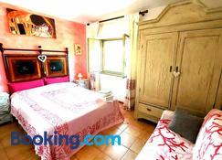 Bed & Breakfast Il Rosmarino - 博薩 - 臥室