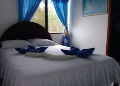 Hostal Insular - Puerto Villamil - Chambre