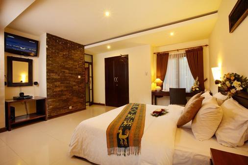 Putu Bali Villa and Spa - Kuta - Bedroom