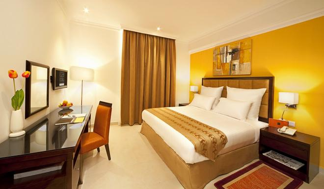 Corp Executive Hotel Doha Suites - Doha - Bedroom