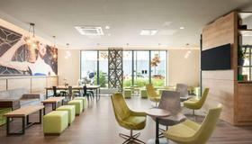 Super 8 by Wyndham Munich City North - München - Lounge