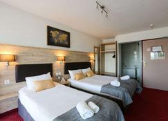 Brit Hotel Bleu Nuit - Saintes - Спальня
