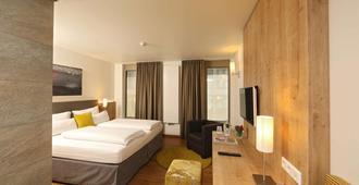 Hotel Goldenes Rad - אולם - חדר שינה