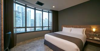 Orchard Grand Court - Singapore - Bedroom