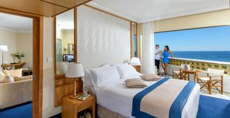 Constantinou Bros Athena Royal Beach Hotel - Pafos - Habitación