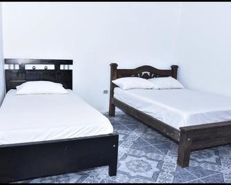 Apartahotel La Ribera El Parnaso - Barrancabermeja - Schlafzimmer