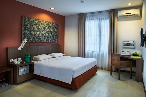 โรงแรมปรายา - เดนปาซาร์ - ห้องนอน