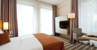Mercure Hotel Aachen am Dom - Ахен - Спальня